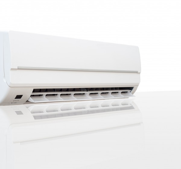White air conditioner with reflection on a glossy surface